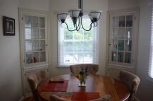 Dining room view from kitchen - we love the built-in cabinets