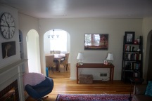 Living room view into dining room - front door on left